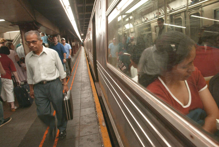Commuters navigate their way through the thirty fouth street/Herald Square subway station.  Subways were running in all of New York City, as the city began its first full day with electricity since Thursday's massive power outage Saturday, Aug. 16, 2003, in New York. (AP Photo/Diane Bondareff)