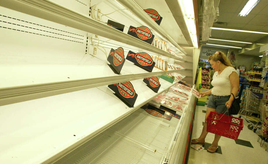 Natalie Matos looks over a limited supply of meat at a Gristede's supermarket in the Chelsea neighborhood of New York, Saturday, Aug. 16, 2003.  Due to the massive power outage in New York on Thursday, Gristede's had to throw away meat and dairy products that spoiled. (AP Photo/Diane Bondareff)