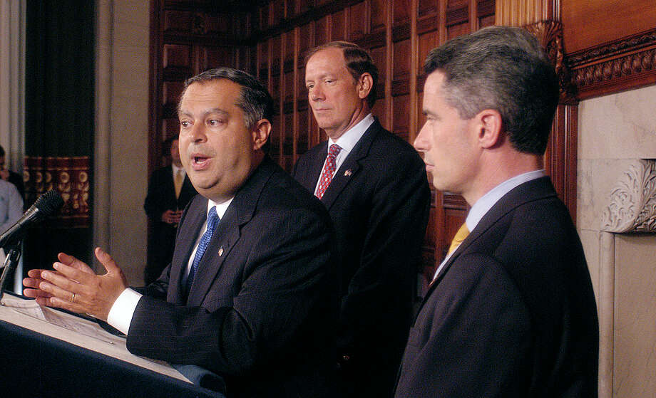 U.S. Energy Secretary Spencer Abraham, left, addresses a news conference as New York Gov. George Pataki, rear middle, and New Jersey Gov. James McGreevey look on at the state Capitol in Albany, N.Y., Saturday, Aug. 16, 2003. Abraham said people in the Midwest and Northeast should be ready for rolling blackouts until the region's shaken power grid is fully operational. (AP Photo/Stewart Cairns)