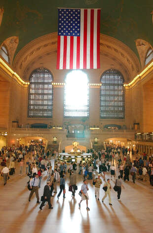 Commuters walk through the main concourse of Grand Central Terminal during morning rush hour, Monday, Aug. 18, 2003, in New York. The morning commute went as planned with no major problems for millions of people on their way to work on the first Monday after last week's blackout. (AP Photo/Mary Altaffer)