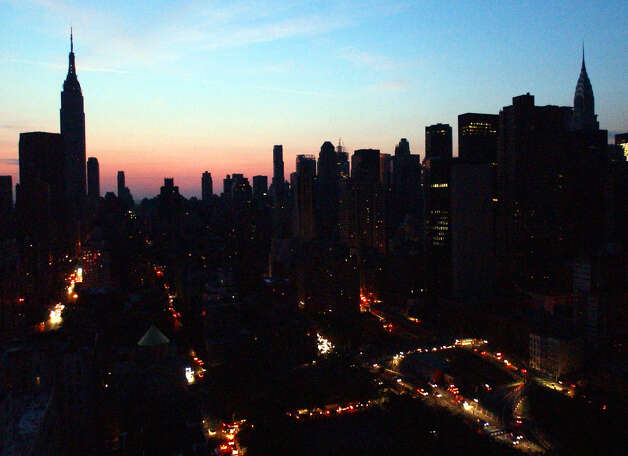 Cars try to navigate their way through New York City during a blackout that hit U.S. and Canadian cities in this Aug. 14, 2003, file photo. A year after the nation's worst ever blackout, utilities have made improvements and New York has spent millions of dollars on new high-tech gadgets to avert the chaos that followed. (AP Photo/Frank Franklin II, File)
