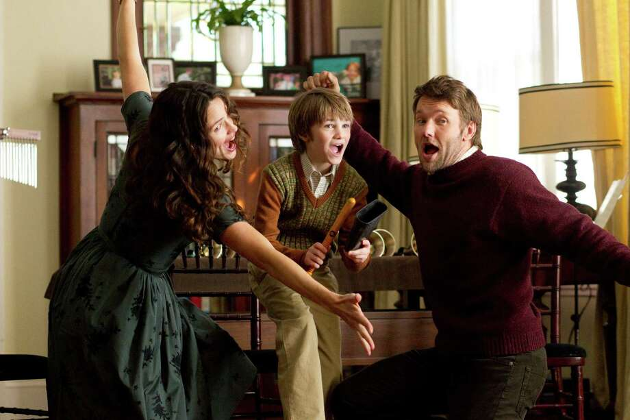 "Jennifer Garner, CJ Adams and Joel  Edgerton  perform at a family gathering in  ""The Odd Life of Timothy Green."" Photo: Disney Enterprises Inc. / ©Disney Enterprises, Inc. All Rights Reserved."
