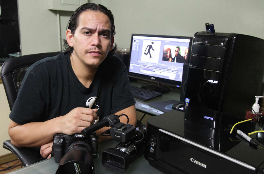 Efrain-Abran Gutierrez, son of Chicano filmmaker Efrain Gutierrez, is continuing his father's craft of filmmaking but has also delved into the world of hip-hop and rap videos. Photo: John Davenport, San Antonio Express-News / John Davenport/©San Antonio Exp