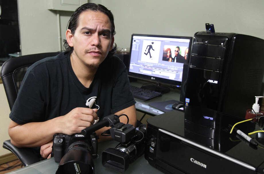 Efrain-Abran Gutierrez, son of Chicano filmmaker Efrain Gutierrez, is continuing his father's craft of filmmaking but has also delved into the world of hip-hop and rap videos. Photo: John Davenport, San Antonio Express-News / John Davenport/©San Antonio Exp