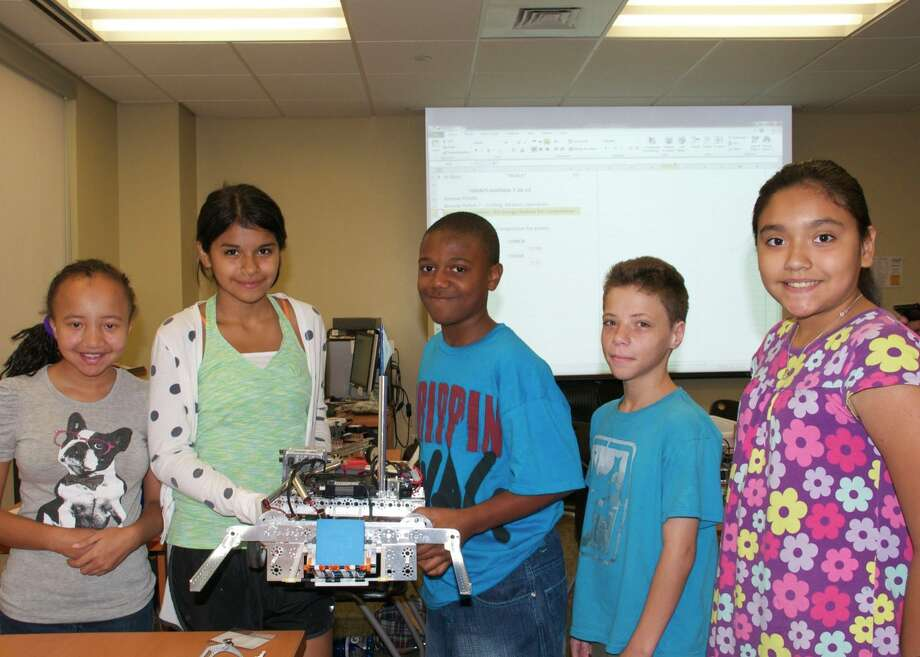 Five students on scholarship from the Northeast Partnership attend the week long Robotics Camp at Northeast Lakeview College. From left are Jolie Haley, Lydia Alcantar, MaÕ Kenan Mitchell, Leif Johnson and Sophia Flores. Photo: Photo Courtesy Of Kathleen Johns