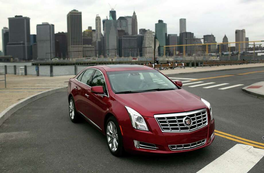 The 2013 Cadillac XTS is less expensive than its luxury-sedan competitors from BMW, Audi and Lexus. (Mike Appleton/Cadillac/MCT) Photo: GM, McClatchy-Tribune News Service / Cadillac
