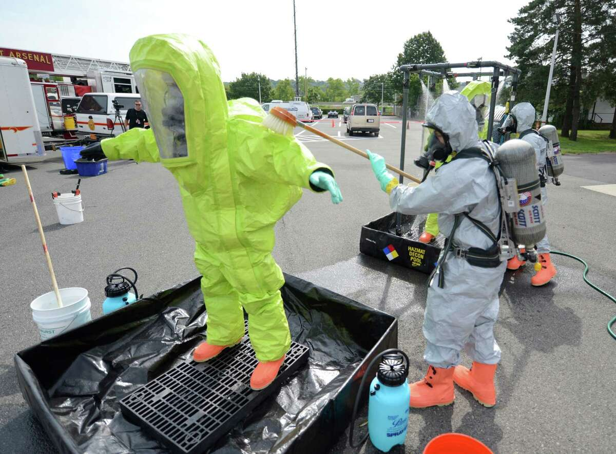 Firefighters and law enforcement personnel gather for a drill at the Watervliet Arsenal in Watervliet, N.Y. Aug 14, 2012. The drill tested and evaluated the arsenal's ability to respond to a simulated hazardous material incident. (Skip Dickstein/Times Union)