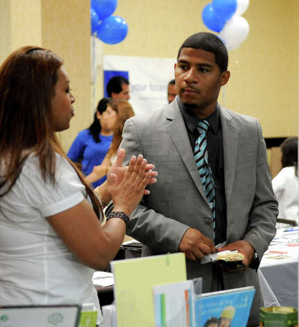 Maria C. Illescas, left, speaks with Fabian Durango, right, at the Hispanic CHamber of Commerce Business Expo at the Stamford Sheraton on Tuesday, August 14, 2012. Photo: Lindsay Niegelberg / Stamford Advocate
