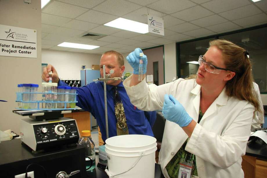 Michelle Coleman, right, works in the lab with Danny Kainer, a professor at Lone Star College Montgomery for 10 years, who now serves as the director of biotechnology institute. He said the algae project has invigorated the department. Photo: Lindsay Peyton