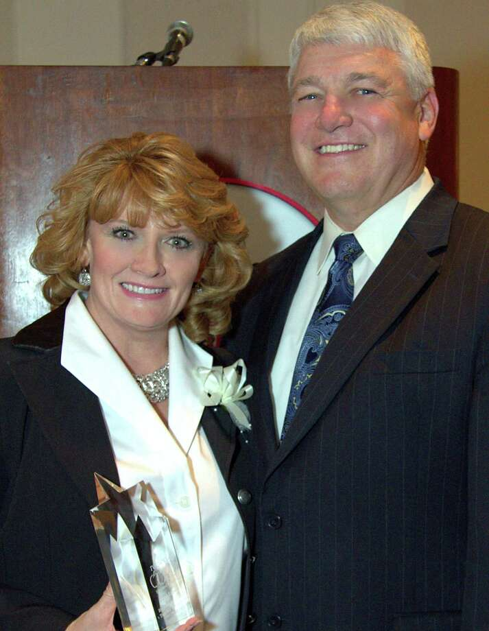 Jami Lupold is congratulated by Pasadena ISD Superintendent Kirk Lewis after accepting her award. Photo: JamiLupold