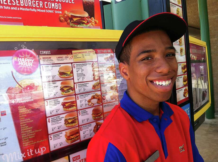 """Deiontaé """"Smilez"""" Day is a Sonic carhop in Universal City. He's competing today in the 2012 Sonic Skate-Off, which picks the best Sonic carhop in the nation. Photo: Réne A. Guzman, San Antonio Express-News"""