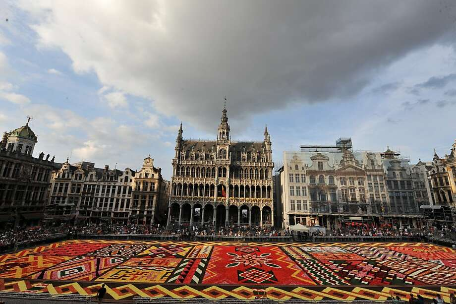 A carpet of flowers inspired by African fabrics fills Brussels' Grand Place. The Belgian city is now a global hub as the unofficial capital of the European Union. Photo: Georges Gobet, AFP/Getty Images