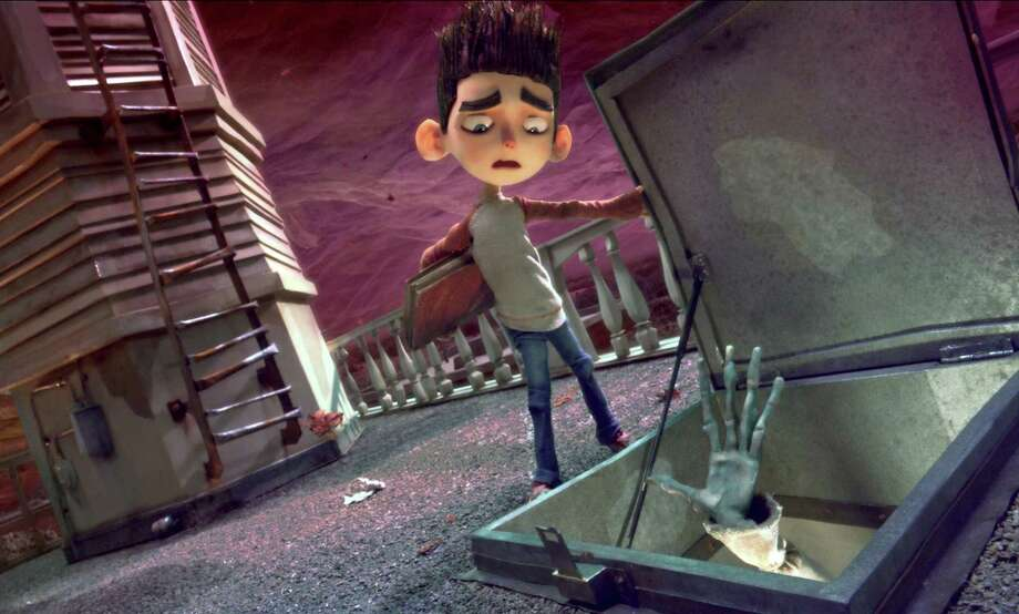 Norman (voiced by Kodi Smit-McPhee) is surprised by a zombie in ParaNorman, the new 3D stop-motion comedy thriller Photo: Focus Features