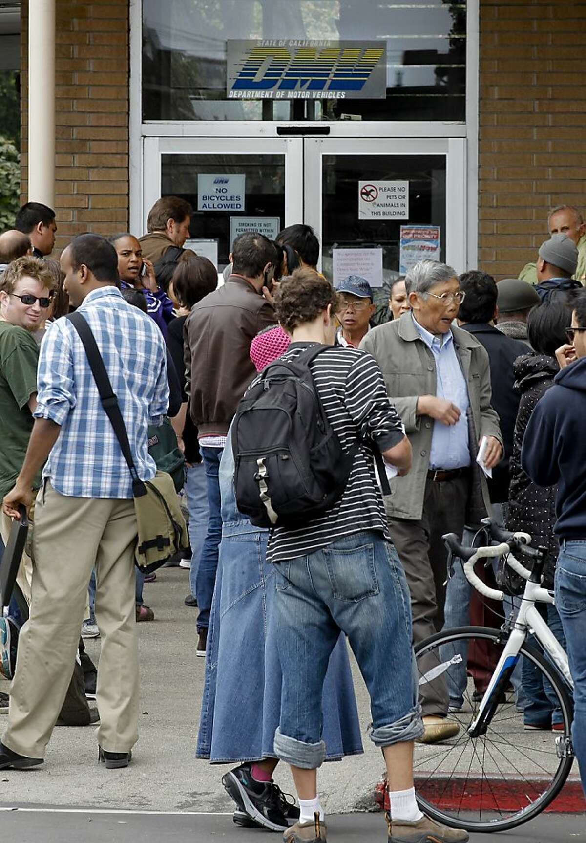 Dozens wait outside for the doors to open at the California Department of Motor Vehicles office on Fell Street in San Francisco, Calif., on Tuesday August 14, 2012. The computer system used by the California Department of Motor Vehicles was down for several hours this morning forcing many of the statewide locations to shut their doors until the problem was fixed.