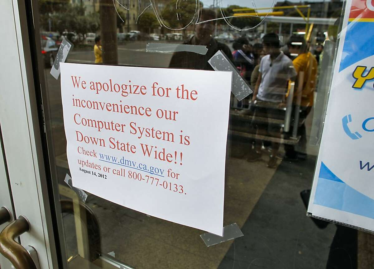 Dozens gathered at the closed doors of the California Department of Motor Vehicles office on Fell Street in San Francisco, Calif., on Tuesday August 14, 2012. The computer system used by the California Department of Motor Vehicles was down for several hours this morning forcing many of the statewide locations to shut their doors until the problem was fixed.