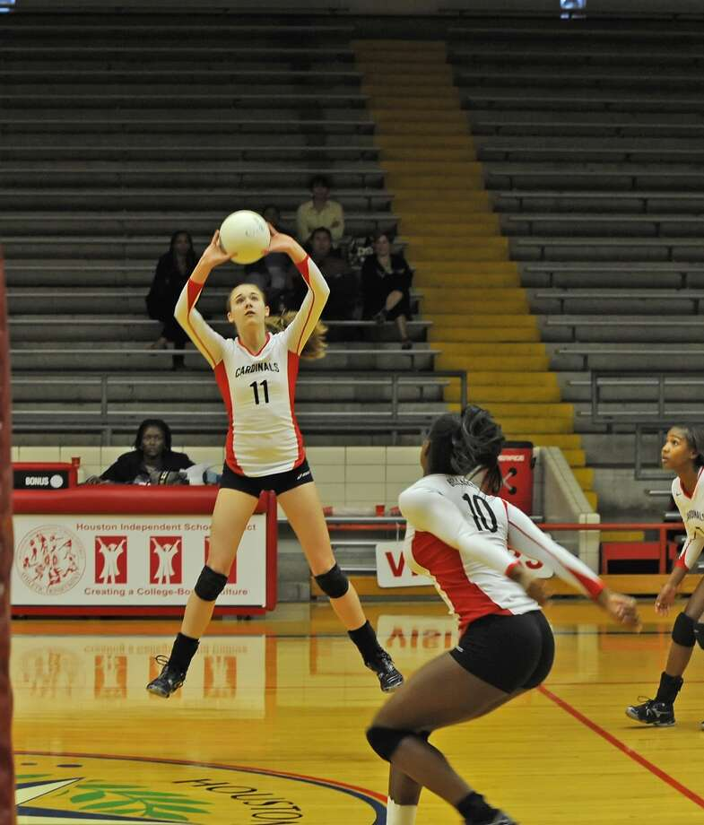 Bellaire and Westbury High Schools played a district volleyball game at Butler Field House, 10-11-11.  Bellaire won the contest in three straight games by the scores of, 25-12, 25-15, 25-13.    Bellaire setter #11 Marguerite Grubb sets the ball for her teammate.   Photo Eddy Matchette Photo: Eddy Matchette / freelance