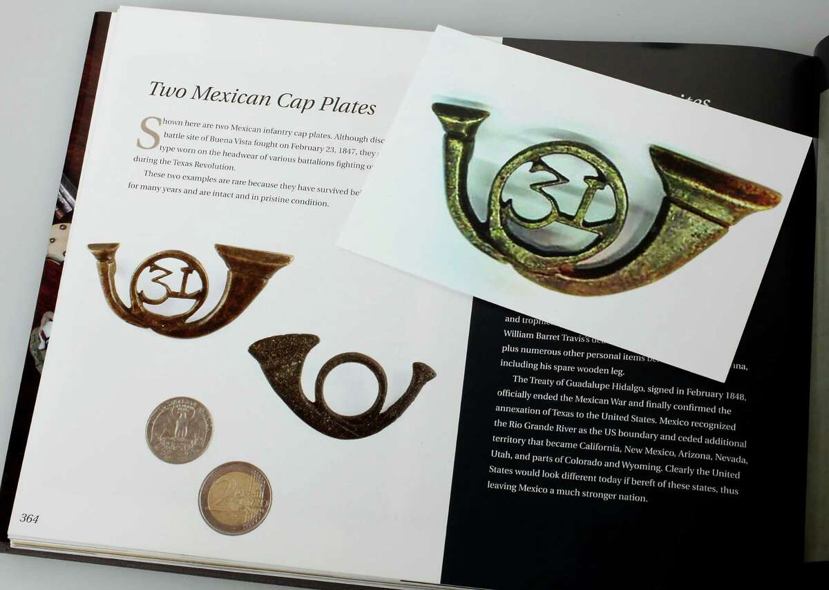 A photo provided by Victoria collector Don Jank of a Mexican cap plate reveals similarities with an item in Phil Collins' book. Jank said the plate and hundreds of others were stolen from him in 2010. Photo by Juanito M. Garza