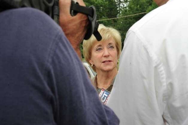 Republican candidate for U.S. Senate Linda McMahon speaks with the media after coming to vote at District 11, North Street School. Greenwich Republicans and Democrats head to the polls Tuesday Aug. 14, 2012, to vote in the primary for U.S. Senate. Photo: Helen Neafsey / Greenwich Time