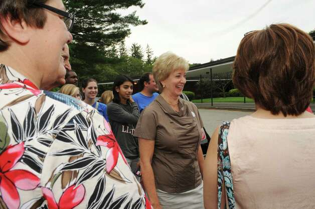 Republican candidate for U.S. Senate Linda McMahon speaks with supporters before voting in the primary at North Street School Tuesday, Aug. 14, 2012. Photo: Helen Neafsey / Greenwich Time