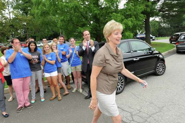 Republican candidate for U.S. Senate Linda McMahon goes to vote at North Street School while supporters applaud primary day Tuesday, Aug. 14, 2012. Photo: Helen Neafsey / Greenwich Time