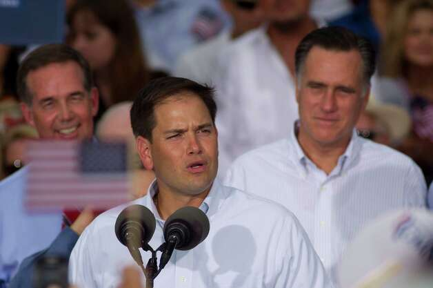 U.S. Rep. Marco Rubio (R-Fla.) introduces Mitt Romney, back right, during a campaign stop in Miami, Monday, Aug. 13, 2012.  (AP Photo/J Pat Carter) Photo: J Pat Carter, Associated Press / AP