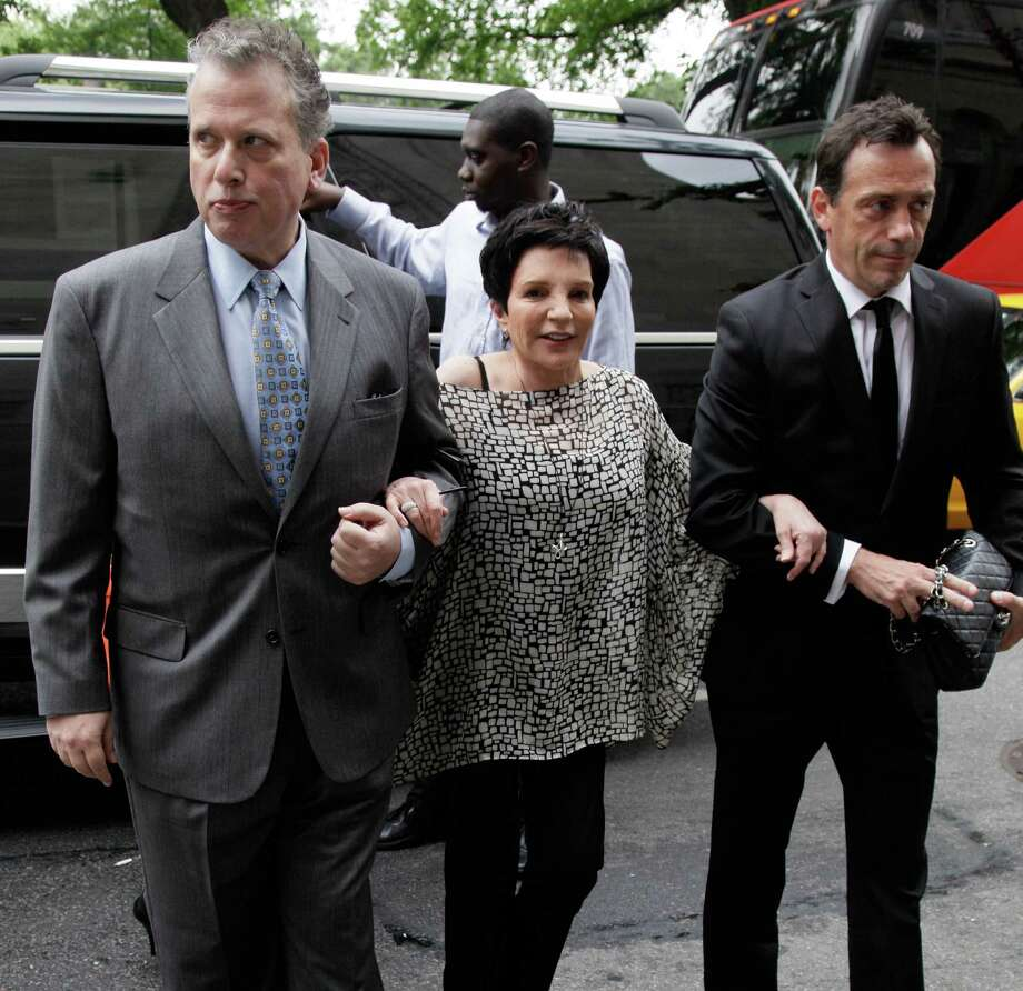 "Liza Minnelli arrives for the funeral of Marvin Hamlisch, in New York's Temple Emanu-El, Tuesday, Aug. 14, 2012. Hamlisch composed or arranged hundreds of scores for musicals and movies, including ""A Chorus Line"" on Broadway and the films ""The Sting,"" ''Sophie's Choice,"" ''Ordinary People"" and ""The Way We Were."" He won three Oscars, four Emmys, four Grammys, a Tony, a Pulitzer and three Golden Globes. Hamlisch died Aug. 6 in Los Angeles at age 68. (AP Photo/Richard Drew) Photo: Richard Drew"
