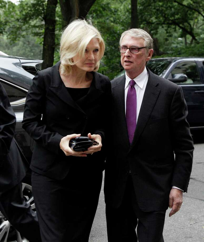 "Broadcaster Diane Sawyer and her husband, director Mike Nichols, arrive for the funeral of Marvin Hamlisch, in New York's Temple Emanu-El, Tuesday, Aug. 14, 2012. Hamlisch composed or arranged hundreds of scores for musicals and movies, including ""A Chorus Line"" on Broadway and the films ""The Sting,"" ''Sophie's Choice,"" ''Ordinary People"" and ""The Way We Were."" He won three Oscars, four Emmys, four Grammys, a Tony, a Pulitzer and three Golden Globes. Hamlisch died Aug. 6 in Los Angeles at age 68. (AP Photo/Richard Drew) Photo: Richard Drew"
