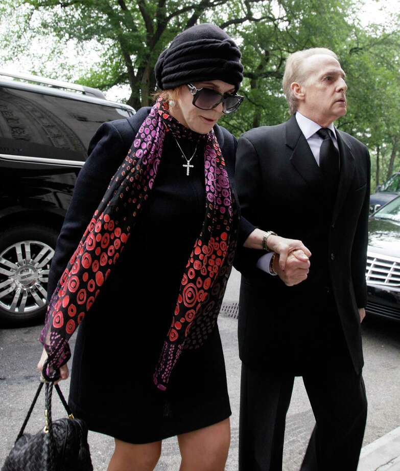 "Actress, singer and dancer Ann-Margret arrives for the funeral of Marvin Hamlisch, in New York's Temple Emanu-El, Tuesday, Aug. 14, 2012. Hamlisch composed or arranged hundreds of scores for musicals and movies, including ""A Chorus Line"" on Broadway and the films ""The Sting,"" ''Sophie's Choice,"" ''Ordinary People"" and ""The Way We Were."" He won three Oscars, four Emmys, four Grammys, a Tony, a Pulitzer and three Golden Globes. Hamlisch died Aug. 6 in Los Angeles at age 68. (AP Photo/Richard Drew) Photo: Richard Drew"