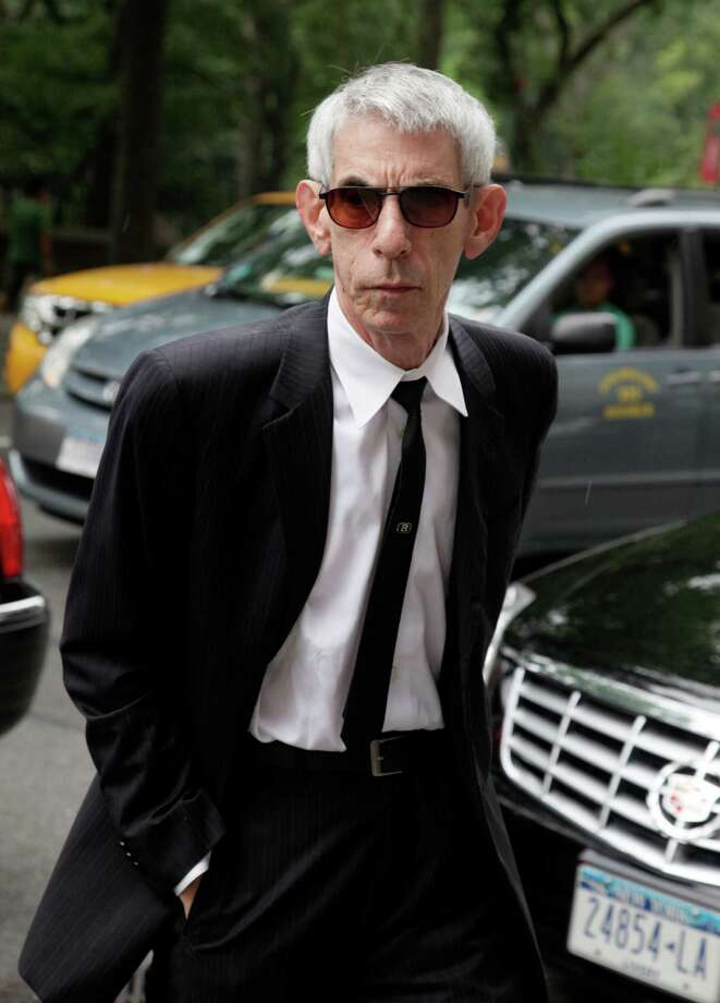 "Actor and comedian Richard Belzer arrives for the funeral of Marvin Hamlisch, in New York's Temple Emanu-El, Tuesday, Aug. 14, 2012. Hamlisch composed or arranged hundreds of scores for musicals and movies, including ""A Chorus Line"" on Broadway and the films ""The Sting,"" ''Sophie's Choice,"" ''Ordinary People"" and ""The Way We Were."" He won three Oscars, four Emmys, four Grammys, a Tony, a Pulitzer and three Golden Globes. Hamlisch died Aug. 6 in Los Angeles at age 68. (AP Photo/Richard Drew) Photo: Richard Drew"