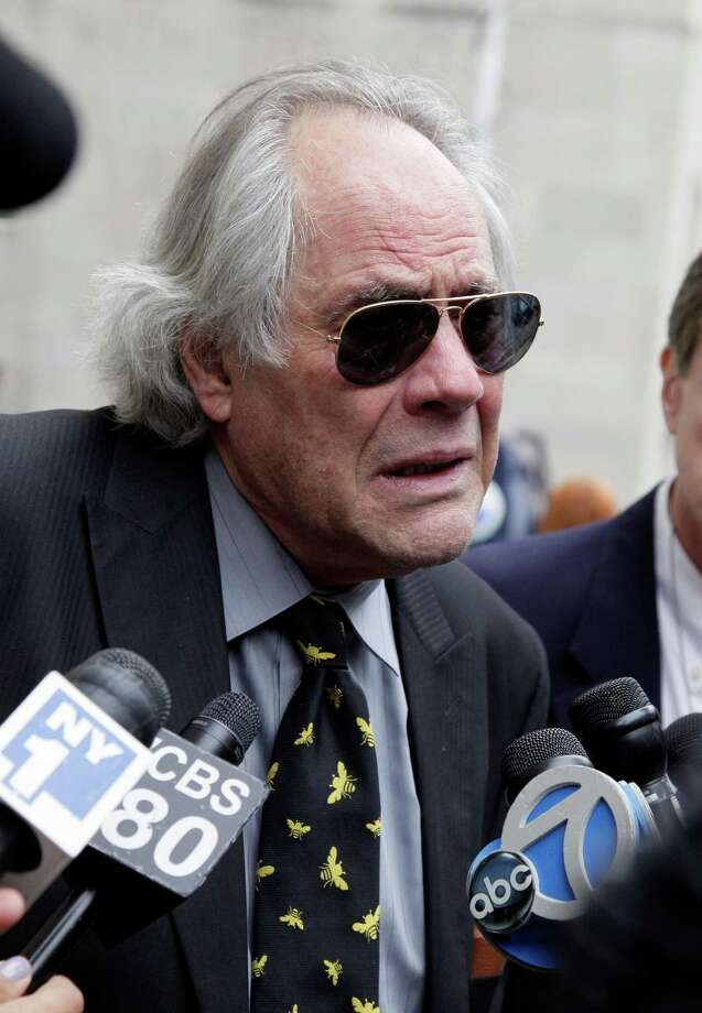"""Actor and comedian Robert Klein arrives for the funeral of Marvin Hamlisch, in New York's Temple Emanu-El, Tuesday, Aug. 14, 2012. Hamlisch composed or arranged hundreds of scores for musicals and movies, including """"A Chorus Line"""" on Broadway and the films """"The Sting,"""" ''Sophie's Choice,"""" ''Ordinary People"""" and """"The Way We Were."""" He won three Oscars, four Emmys, four Grammys, a Tony, a Pulitzer and three Golden Globes. Hamlisch died Aug. 6 in Los Angeles at age 68. (AP Photo/Richard Drew) Photo: Richard Drew"""