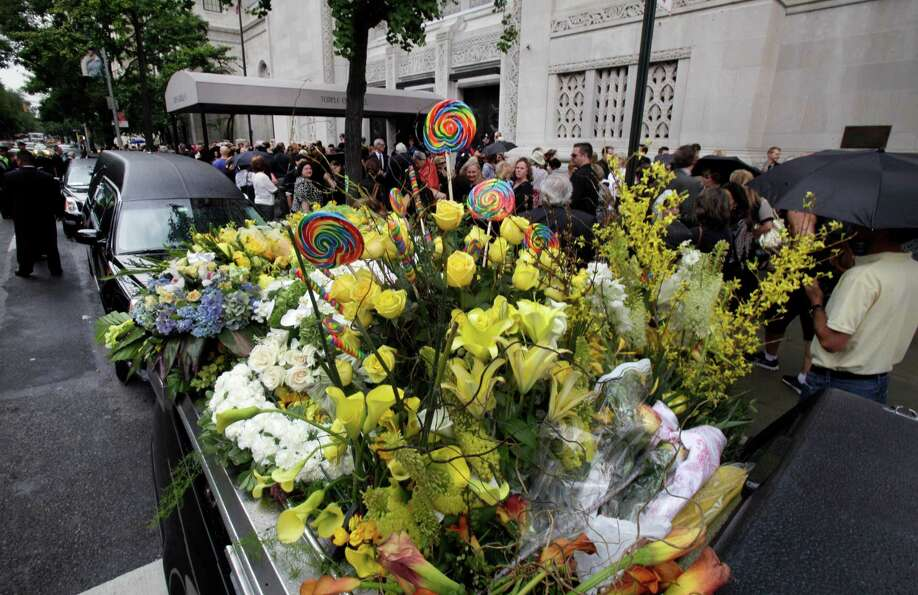 The flower car, bearing lollipops and roses, is parked in front of New York's Temple Emanu-El, after