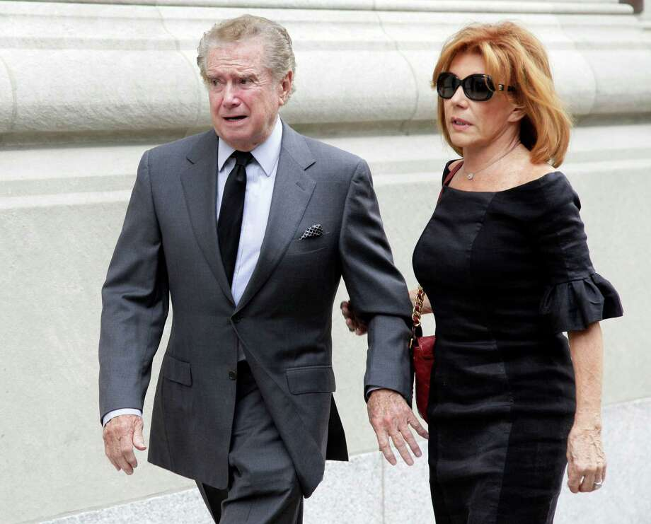 "Regis Philbin, and his wife Joy Philbin, arrive for the funeral of Marvin Hamlisch, in New York's Temple Emanu-El, Tuesday, Aug. 14, 2012. Hamlisch composed or arranged hundreds of scores for musicals and movies, including ""A Chorus Line"" on Broadway and the films ""The Sting,"" ''Sophie's Choice,"" ''Ordinary People"" and ""The Way We Were."" He won three Oscars, four Emmys, four Grammys, a Tony, a Pulitzer and three Golden Globes. Hamlisch died Aug. 6 in Los Angeles at age 68. (AP Photo/Richard Drew) Photo: Richard Drew"
