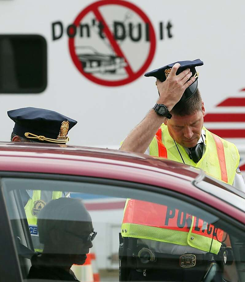 WASHINGTON, DC - AUGUST 14:  Washington Metropolitan Police conduct a sobriety check point associated with a news conference on drunk driving, on August 14, 2012 in Washington, DC. The National Highway Traffic Safety Administration (NHTSA) held a news conference to discuss the national anti-drunk driving campaign and law enforcement crackdown.  (Photo by Mark Wilson/Getty Images) Photo: Mark Wilson, Getty Images