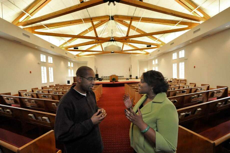 Rev Ivan Pitts talks with church member Cindy Clarke in the newly built section of New Hope Baptist Church in Danbury on Wendesday, Dec.2,2009. Photo: Michael Duffy / The News-Times