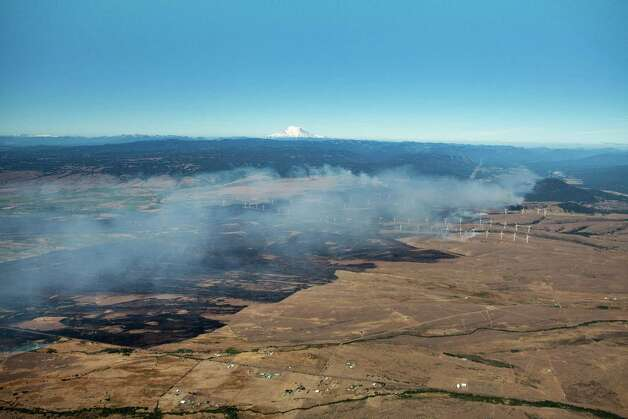 An aerial view of a wildfire just east of Cle Elum. The wildfire has already destroyed 60 homes and burned across nearly 45 square miles on the east slope of the Cascades. Photo: Dan Crowell/Soundview Aerial