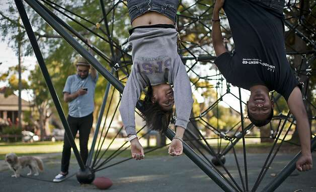 Blanca Vazquez hangs out with friends last month in a Berkeley park. Vazquez won't be applying for a work permit right away. Photo: Yue Wu, The Chronicle