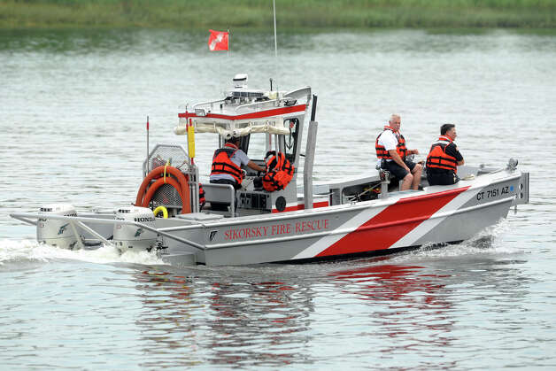 A rescue boat from Sikorsky Aircraft takes part in a search of the Housatonic River, seen here from Shelton, Conn., following a report of a possible boat in distress with a person overboard, Aug. 14th, 2012. Photo: Ned Gerard / Connecticut Post