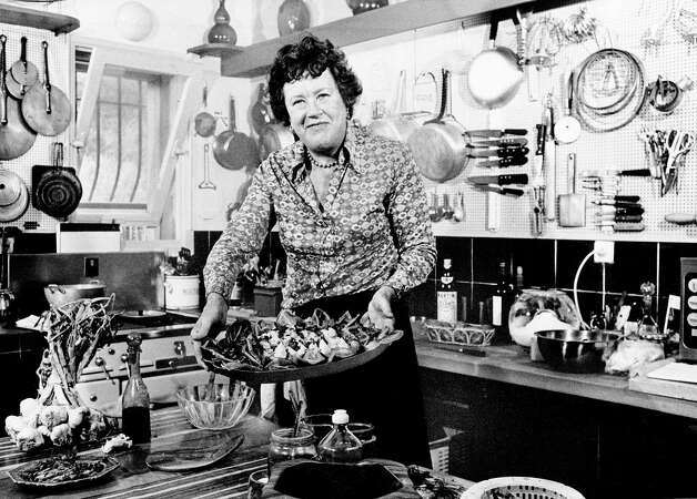 FILE- In this Aug. 21, 1978 file photo shows American television chef Julia Child showing a salade nicoise she prepared in the kitchen of her vacation home in Grasse, southern France.  More so than the tools and techniques she popularized,  Child's most lasting legacy may be her spirit and sense of humor. That was the conclusion of several chefs and food magazine editors asked to describe Child's memorable contributions to American home cooking as a new movie about her life is about to open. (AP Photo) Photo: Anonymous / AP