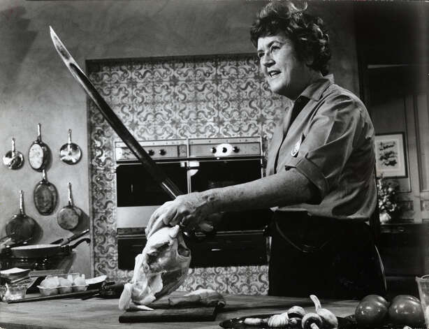 Julia Child approaches cooking in the swashbuckling fashion that has made her the darling of public television. Julia Child cooking expert. No credit, Houston Chronicle files dated Nov. 11, 1971. / handout