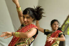 Aditi Ghatlia, left, and Reeya Bhavsar perform the Desi Girl / Aaja Nachale dance during the 2nd Annual Jai Ho India Festival on the green at Ives Street in Danbury on Saturday, Aug. 12, 2011. Ghatlia is from Southbury and Bhavsar is from Bethel.