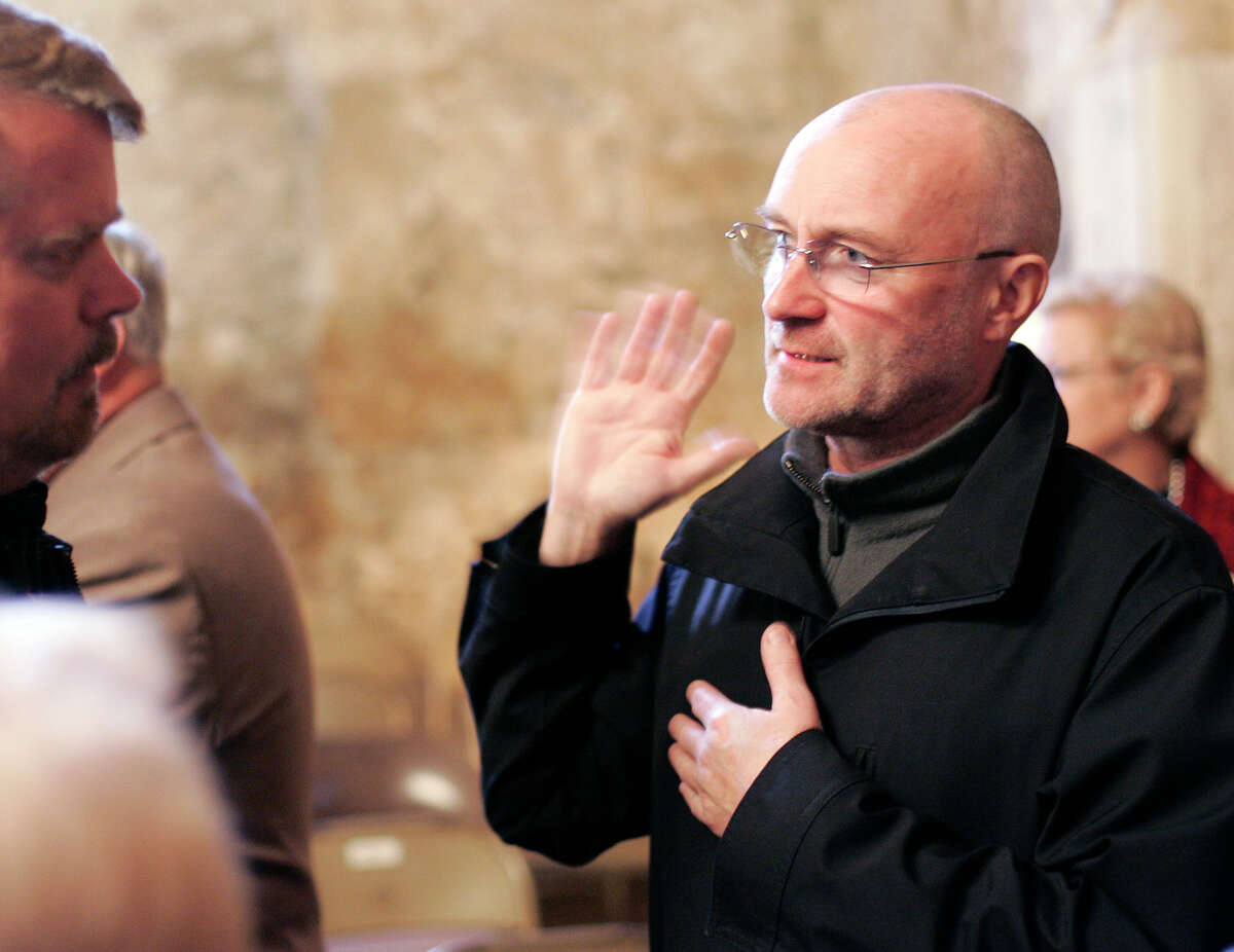 British pop music superstar and history buff Phil Collins talks about his interest in the Alamo as he was on hand Thursday when the Alamo Mission Chapter of the Daughters of the Republic of Texas hold the Annual Memorial Service to the Heroes of the Alamo in the Alamo Shrine, Mar. 6, 2008.