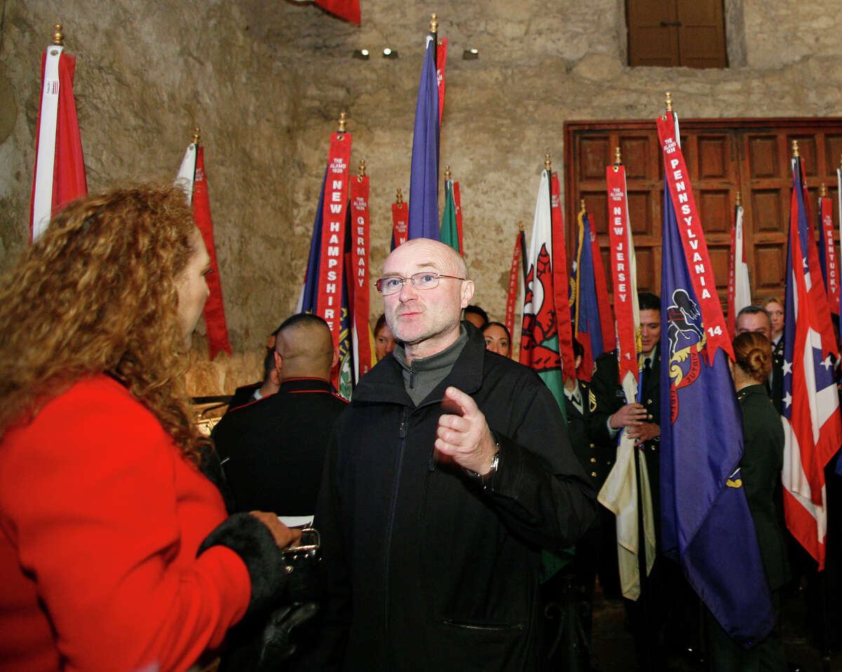 British pop music superstar and history buff Phil Collins talks with DRT memeber Laura Garcia, left as he was on hand Thursday when the Alamo Mission Chapter of the Daughters of the Republic of Texas hold the Annual Memorial Service to the Heroes of the Alamo in the Alamo Shrine, Thursday afternoon, Mar. 6, 2008.