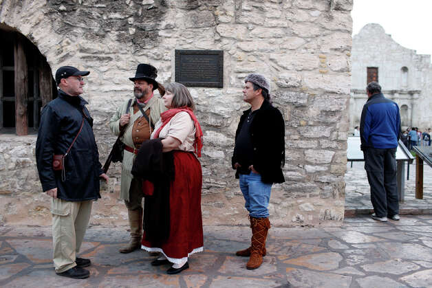 Singer and Alamo collector Phil Collins, left, talks with reenactors John Potter and Carol Pape after the Dawn at the Alamo in San Antonio on Friday, March 6, 2009. Potter and Pape are getting married to each other in front of the Alamo on Friday at 6 p.m. Photo: LISA KRANTZ, SAN ANTONIO EXPRESS-NEWS / lkrantz@express-news.net