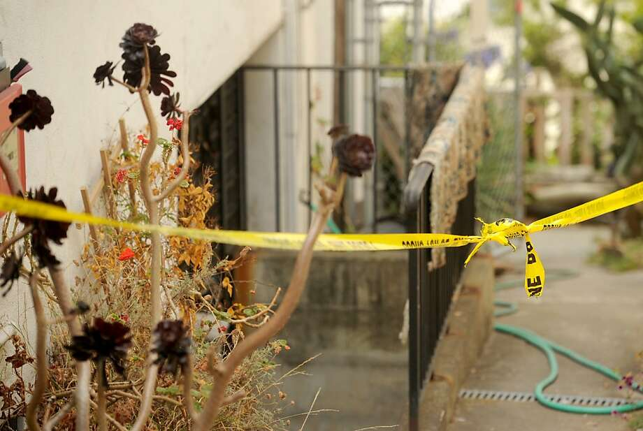Police tape seals an entrance to the Coventry Road home where 81-year-old retired psychologist James Durkin was found stabbed to death in Kensington, Calif., on Tuesday, Aug. 14, 2012. Photo: Noah Berger, Special To The Chronicle