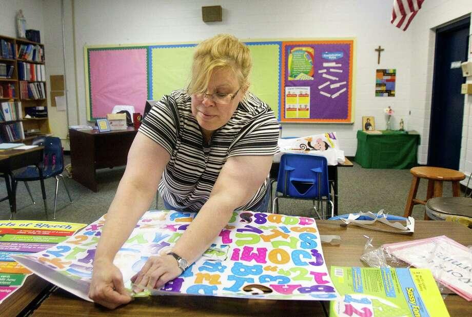 Allison Cogburn gets her classroom ready at Corpus Christi Catholic School in Houston. It has 215 students. Photo: Cody Duty / © 2011 Houston Chronicle