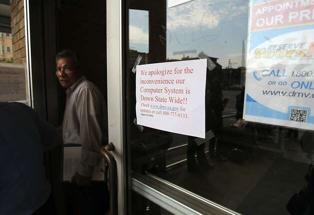 An unidentified man exits the DMV on Fell Street on Tuesday, August 14, 2012 in San Francisco, Calif. Photo: Megan Farmer, The Chronicle