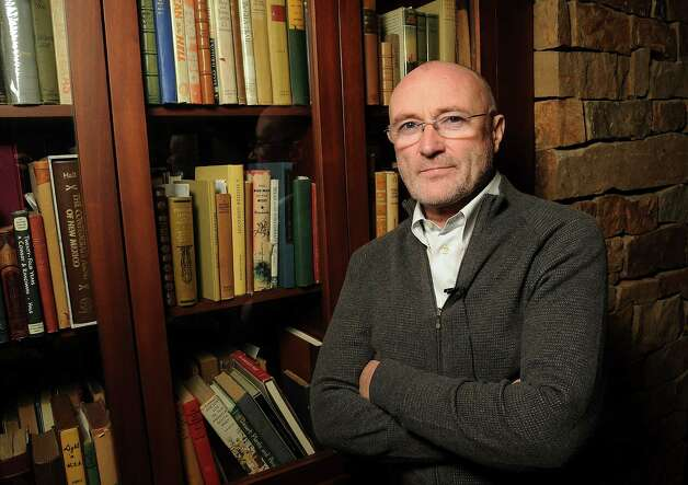 Author Phil Collins at a invitation-only reception and book-signing at Torch Energy Advisors Wednesday May 9,2012. (Dave Rossman Photo) Photo: Dave Rossman / © 2012 Dave Rossman