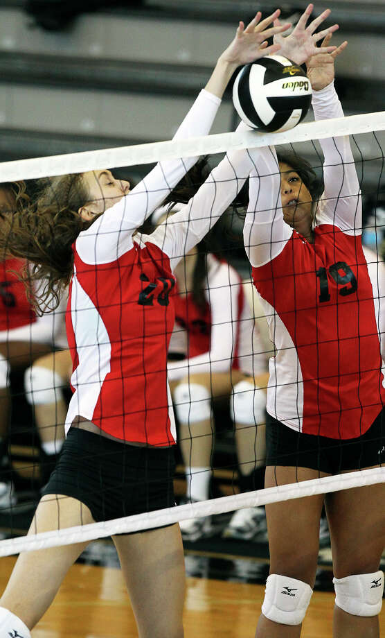 New Braunfels Canyon's Megan Isbell (left) and Celeste Ayala team up for a block in a 3-0 victory over Seguin at Steele. Photo: Tom Reel, San Antonio Express-News / ©2012 San Antono Express-News