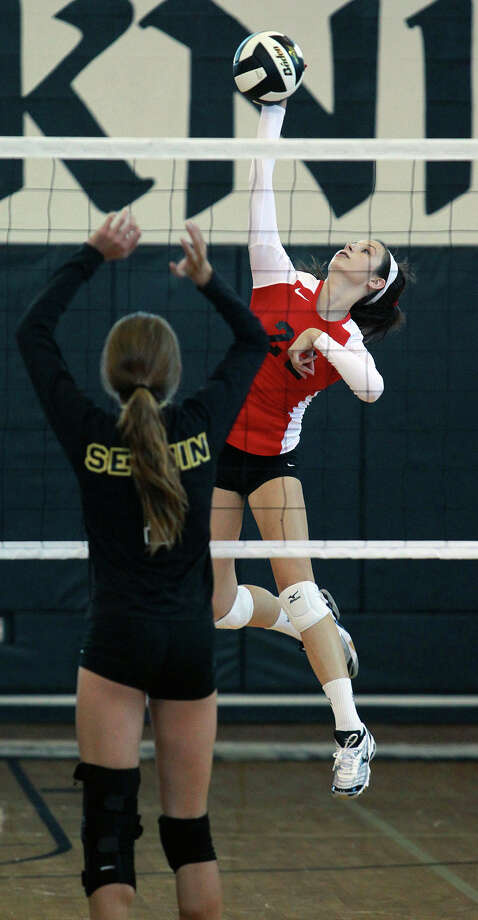 Madison Williams goes up for a slam as New Braunfels Canyon beats Seguin 3-0 at Steele High School gym on Tuesday, Aug. 14, 2012. Photo: Tom Reel, San Antonio Express-News / ©2012 San Antono Express-News