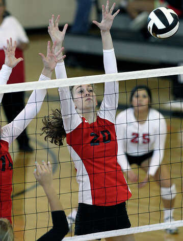 Megan Isbell goes up for a block as New Braunfels Canyon beats Seguin 3-0 at Steele High School gym on Tuesday, Aug. 14, 2012. Photo: Tom Reel, San Antonio Express-News / ©2012 San Antono Express-News